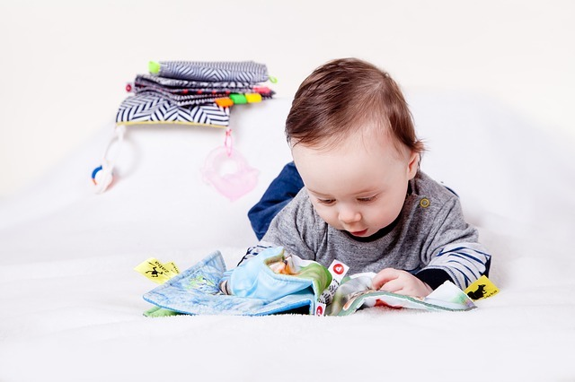 toddler looking at book
