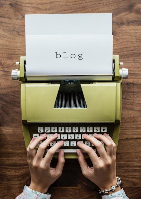 typing word blog on old typewriter